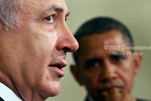 United States President Barack Obama (R) listens to Prime Minister, Benjamin Netanyahu of Israel (L) speak in the Oval Office at the White House on Tuesday, July 6, 2010 in Washington, DC. The two leaders spoke to reporters and are scheduled to participate in a working lunch.  .Credit: Mark Wilson - Pool via CNP