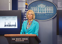 United States Secretary of Education Betsy DeVos acknowledges the donation of US President Donald Trumps's quarterly salary to the Education Department at The White House in Washington, DC, July 26, 2017. <br /> Credit: Chris Kleponis / CNP /MediaPunch