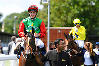 Winner of The Sorvio Insurance Brokers Maiden Auction Fillies' Stakes  Elegant Erin ridden by Tom Marquand and trained by Richard Hannon is led into the Winners enclosure during Horse Racing at Salisbury Racecourse on 15th August 2019