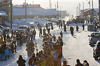 Musher Cari Miller heads out of the start shoot on Front Street in Nome for the start of the 2008 All Alaska Sweepstakes 100 year commemorative sled dog race.