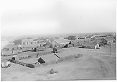 A wide view of the original D&amp;RG Alamosa depot and yards prior to the 1907 fire.  Many standard and narrow gauge cars are in view.<br /> D&amp;RG  Alamosa, CO  Taken by Davis, O. T. - 1900