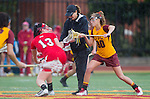 Los Angeles, CA 02/28/14 - Referee, Jamie Romano (Marist #13) and Alex Moore (USC #30) in action during the Marist Red Foxes vs University of Southern California Trojans NCAA Women's lacrosse game at Loker Track Stadium on the USC Campus.  Marist defeated USC 12-10.