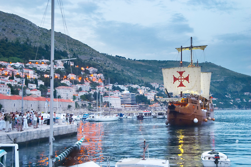The Karaka 16 century galleon replica boat in the old harbour in evening blue light Dubrovnik, old city. Dalmatian Coast, Croatia, Europe.
