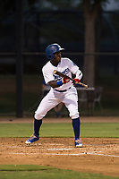 AZL Dodgers right fielder Rolando Lebron (13) shows bunt during an Arizona League game against the AZL White Sox at Camelback Ranch on July 3, 2018 in Glendale, Arizona. The AZL Dodgers defeated the AZL White Sox by a score of 10-5. (Zachary Lucy/Four Seam Images)