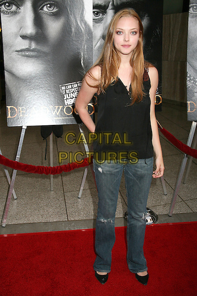 "AMANDA SEYFRIED.HBO's ""Deadwood"" Season Premiere at the Cinerama Dome, Hollywood, California, USA..June 6th, 2006.Photo: Byron Purvis/AdMedia/Capital Pictures.Ref: BP/ADM.full length jeans denim black top.www.capitalpictures.com.sales@capitalpictures.com.© Capital Pictures."