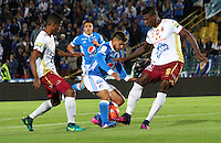 BOGOTA -COLOMBIA, 22-02-2017. Jacobo Kouffaty (Center) player of Millonarios  fights the ball agaisnt of Sergio Mosquera (R) player of Deportes Tolima .Action game beteween  Millonarios  and Tolima  during match for the date 5 of the Aguila League I 2017 played at Nemesio Camacho El Campin stadium . Photo:VizzorImage / Felipe Caicedo  / Staff
