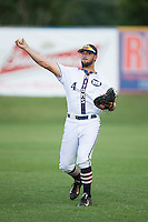 Peter Johnson (4) of the High Point-Thomasville HiToms warms up in the outfield prior to the game against the Asheboro Copperheads at Finch Field on June 12, 2015 in Thomasville, North Carolina.  The HiToms defeated the Copperheads 12-3. (Brian Westerholt/Four Seam Images)