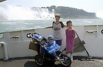 Niagara Falls, Ontario, Canada - 01 August 2006---Children posing during a cruise on the Niagara River, with the American Falls on the United States' side in the back---nature, landscape, people, tourism---Photo: © HorstWagner.eu