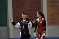 SCHAATSEN: SALT LAKE CITY: Utah Olympic Oval, 12-11-2013, Essent ISU World Cup, training, Wim den Elsen (trainer KIA Speed Skating Academy), Beixing Wang (CHN), ©foto Martin de Jong