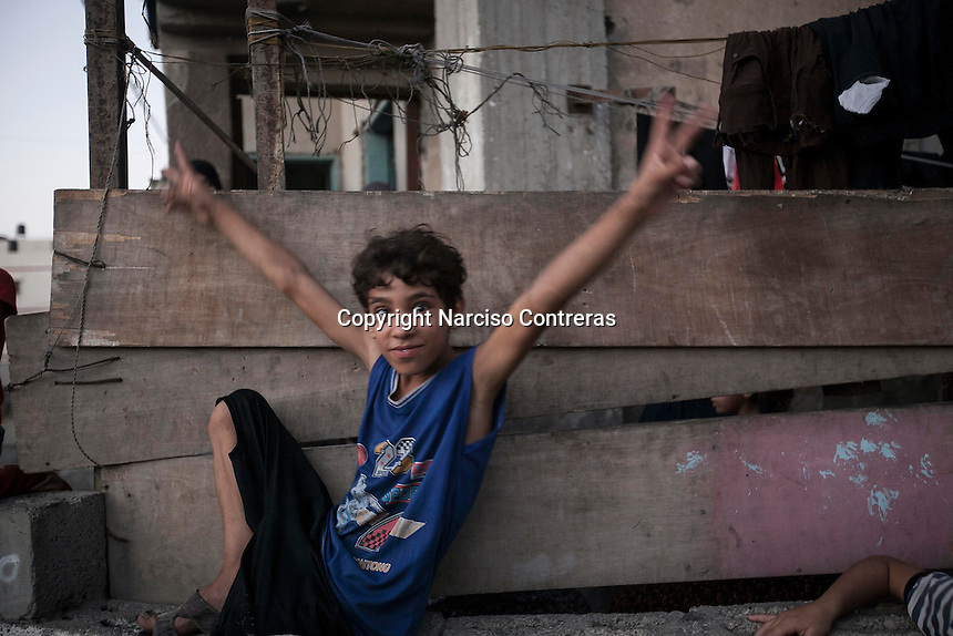 "August 26, 2014 - Gaza City, Gaza strip, Palestinian Territory: A Palestinian child celebrates as new cease fire is announced between Hamas and Israel. The new cease fire marks the end of the ""Protective Edge"" Israeli military operation in the Gaza strip. (Narciso Contreras/Polaris)"
