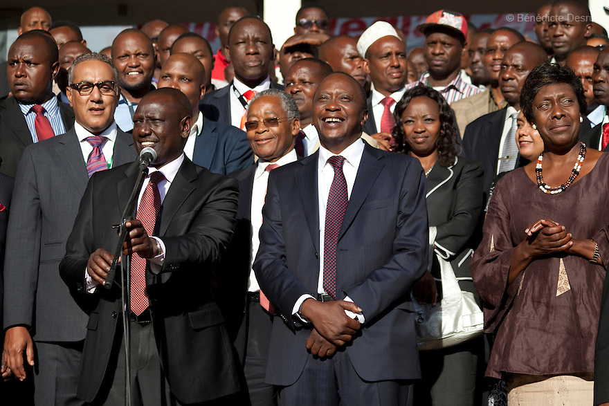 Kenya's President-Elect Uhuru Kenyatta (R) and his running mate William Ruto (L) talk to supporters as they celebrate winning the presidential election after the official result was released in Nairobi, Kenya on March 9, 2013. Uhuru Kenyatta won the Kenya's presidential election with 50.07 % of the vote. Kenyatta faces charges for crimes against humanity at the International Criminal Court for orchestrating the 2007-08 postelection violence. Photo by Benedicte Desrus