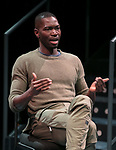 "Tarell Alvin McCraney, playwright of ""Wig Out!"" and Oscar award winning playwright and screenwriter for ""Moonlight,"" talks with students, faculty and staff from the set of ""Wig Out!"" on the Fullerton Stage in The Theatre School building, Friday, April 21, 2017. (DePaul University/Jeff Carrion)"