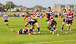 Heriot's RFC v Stirling County RFC, Goldenacre, Edinburgh.<br /> <br /> Pictured: Gavin Cameron is held up by a tackle from Ruaridh Leishman<br /> <br /> Image by: Malcolm McCurrach<br /> Sat, 13, September, 2014. © Malcolm McCurrach 2014. All rights Reserved. picturedesk@nwimages.co.uk | www.nwimages.co.uk | 07743 719366<br /> <br /> JP Resell