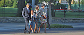 The First Family walks across LaFayette Park to St. John's Episcopal Church on Sunday, September 19, 2010. From left to right: United States President Barack Obama, Sasha Obama, Malia Obama, First Lady Michelle Obama..Credit: Dennis Brack / Pool via CNP