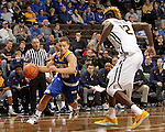 SIOUX FALLS, SD - NOVEMBER 26:  Cole Gentry #10 from South Dakota State University looks to drive past Hanner Mosquera-Perea #12 from East Tennessee State University during their game at the Sanford Pentagon Saturday evening in Sioux Falls. (Photo by Dave Eggen/Inertia)