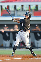 Jeffer Patino #15 of the Bristol White Sox follows through on his swing against the Burlington Royals at Burlington Athletic Stadium August 13, 2010, in Burlington, North Carolina.  Photo by Brian Westerholt / Four Seam Images