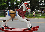 "A view of ""Rockin' Cowboy"" created by, Robin LaPeruta, at intersection of Ulster Avenue and Market Street, one of the ""Rockin' Around Saugerties"" theme Statues on display throughout the Village of Saugerties, NY, on Friday, June 9, 2017. Photo by Jim Peppler. Copyright/Jim Peppler-2017."
