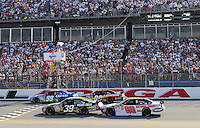 Apr 26, 2009; Talladega, AL, USA; NASCAR Sprint Cup Series drivers Carl Edwards (99), Brad Keselowski (09), Ryan Newman (39) and Dale Earnhardt Jr (88) take the white flag during the Aarons 499 at Talladega Superspeedway. Mandatory Credit: Mark J. Rebilas-