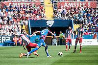 VALENCIA, SPAIN - MARCH 10: Junfran and Arda Turan during BBVA LEAGUE match between Levante U.D. Andr Atletico de Madrid at Ciudad de Valencia Stadium on March 10, 2015 in Valencia, Spain