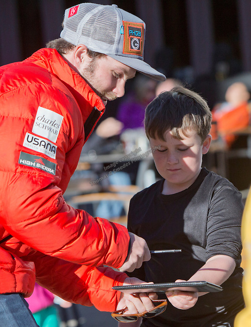 Travis Ganong signs an autograph for a young fan befoe the Olympic Homecoming  Celebration at Squaw Valley on Friday night, March 21, 2014.