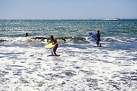California, Marin County, Muir Beach, GGNRA,  Young girls with boogie boards