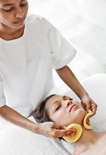 Woman Receiving Facial at Six Senses Spa, Heritance Kandalama, Dambulla, Sri Lanka. The Thai Facial at Six Senses Spa is five-step treatment that involves: cleansing the face with a yogurt-honey mixture; exfoliating the face with raw brown sugar; moisturizing the face with sweet almond oil; applying a facial mask made of blended Thai herbs; and finishing off with cucumber to tone and balance the complexion. Dambulla, Sri Lanka.