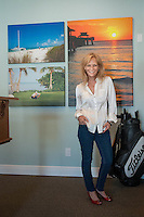 Debi Pittman Wilkey poses in front of her artwork that was sold to FrontDoor Communities for display in a new model home office for Parade of Homes at Andalucia community in Naples, Florida, USA, March 8, 2013. photo/Gary Jung