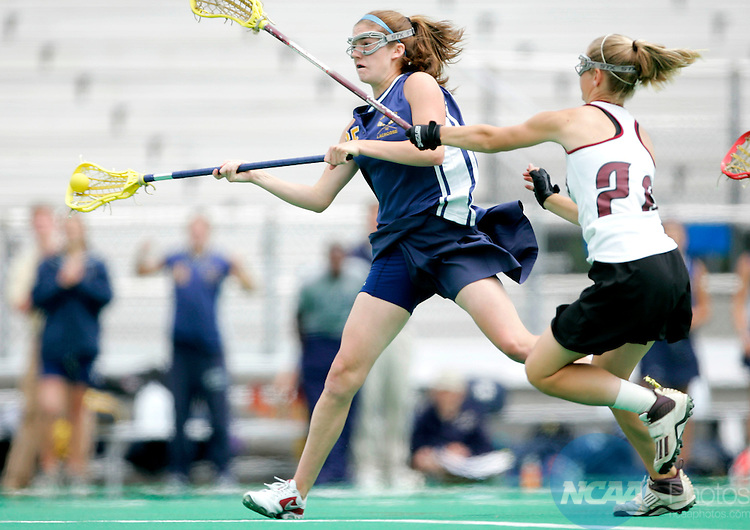 22 MAY 2005: The College of New Jersey's Lauren Dougher (25) takes a shot on goal while being defended by Salisbury's Jessica Froats (26) during the Division III Women's Lacrosse Championship in Ewing, NJ. The College of New Jersey defeated Salisbury University 9-7 to take home their 12th title. J. Andrew Hallowell/NCAA Photos