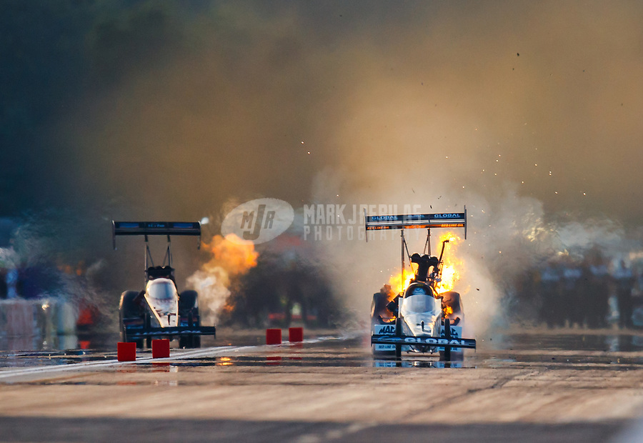 Aug 18, 2017; Brainerd, MN, USA; NHRA top fuel driver Shawn Langdon (right) explodes an engine during qualifying for the Lucas Oil Nationals at Brainerd International Raceway. Mandatory Credit: Mark J. Rebilas-USA TODAY Sports