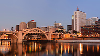 Panorama of St. Paul, Minnesota skyline at dawn viewed from across the Mississippi River.