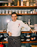 SPAIN, La Rioja, chef Francis Paniego standing in restaurant's kitchen, portrait