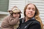 Baby Ryan in monkey costume with Mom on Halloween, October 31, 2012, after Hurricane Sandy, on Long Island, New York, USA