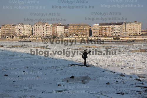 Man takes a selfie standing on the ice on river Danube in Budapest, Hungary on January 10, 2017. ATTILA VOLGYI
