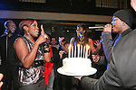 Estelle receives a birthday cake and song from Ne-Yo during the 360 Induced Executive Mixer, hosted by Ne-Yo at Millesime NYC, January 19, 2011.