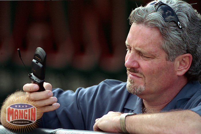 SAN FRANCISCO, CA - General Manager Brian Sabean of the San Francisco Giants talks on his cell phone on the field before a game at Pacific Bell Park in San Francisco, California in 2001. Photo by Brad Mangin