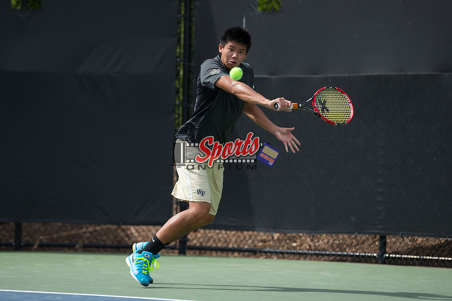 Jon Ho of the Wake Forest Demon Deacons returns the ball during the match against the North Carolina Tar Heels at the Wake Forest Tennis Center on April 11, 2015 in Winston-Salem, North Carolina.  The Demon Deacons defeated the Tar Heels 4-3.    (Brian Westerholt/Sports On Film)
