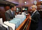 Nevada Secretary of the Senate David Byerman, left, talks with Senate Majority Leader Mo Denis, D-Las Vegas, at the Legislative Building in Carson City, Nev., on Monday, April 15, 2013. .Photo by Cathleen Allison
