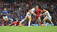 Wales's Adam Thomas picks up an injury as he tackles England's James Rodwell<br /> <br /> Wales Vs England - men's classification 5th - 6th place match<br /> <br /> Photographer Chris Vaughan/CameraSport<br /> <br /> 20th Commonwealth Games - Day 4 - Sunday 27th July 2014 - Rugby Sevens - Ibrox Stadium - Glasgow - UK<br /> <br /> © CameraSport - 43 Linden Ave. Countesthorpe. Leicester. England. LE8 5PG - Tel: +44 (0) 116 277 4147 - admin@camerasport.com - www.camerasport.com