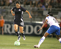 Homare Sawa #10 of the Washington Freedom balances on the ball in front of Candace Chapman #9 of the Boston Breakers during a WPS match at Maryland Soccerplex on July 29, in Boyds, Maryland. Freedom won 1-0.