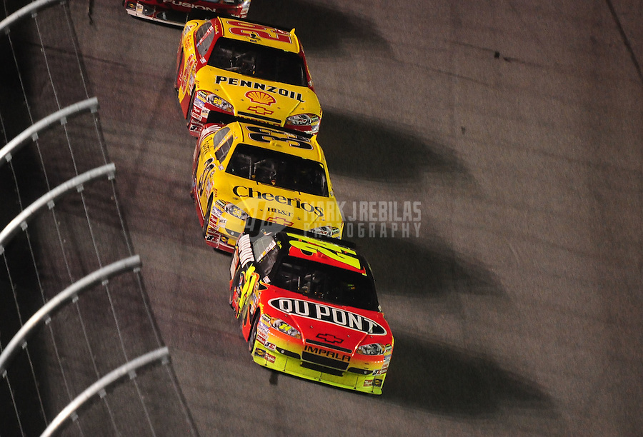Jul. 3, 2010; Daytona Beach, FL, USA; NASCAR Sprint Cup Series driver Jeff Gordon (24) leads Clint Bowyer (33) and Kevin Harvick (29) during the Coke Zero 400 at Daytona International Speedway. Mandatory Credit: Mark J. Rebilas-