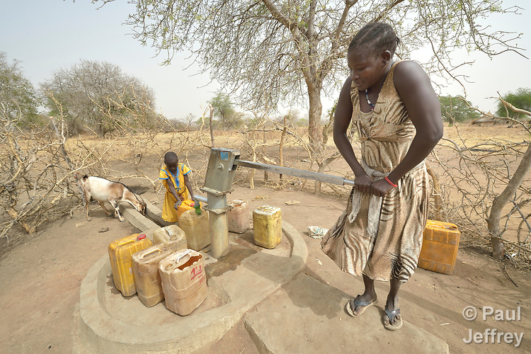 With help from her 8-year old daughter Atap, Atouc Dut pumps water from a well in Malek Miir, a village in South Sudan's Lol State where a persistent drought has destroyed crops and left people hungry. A local partner of Christian Aid, a member of the ACT Alliance, drilled the well and has provided food vouchers to hungry families, including Dut and her husband and four children. With food vouchers instead of bulk food, beneficiaries were able to buy the exact food they wanted, while at the same time supporting local traders and markets.