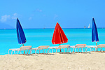 Beach umbrellas, lounge chairs, blue sky and water, St. Marteen