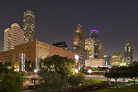 """Houston Skyline at Night -  Houston skyline from Sesquicentennial Park in downtown Houston at night. It was one of those nights with clear sky to create this nighttime image of the skyline. The Sesquicentennial park was established in 1989 along the banks of the Buffalo Bayou along the Theater District.  The park is an 22.5 acrea urban park and was  officially establish in 1986 to commemorate the 150 year anniversary of the founding of the city of Houston.  The park was was done in two phases and was officially finished in 1998.  The park features """"Seven Wonders"""", a set of seven pillars illuminated from within by Houston native Mel Chin along with other sculptures and statues done by local artist along with a statue of George H W Bush our 41 president can be seen looking at the city skyline."""