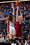 SIOUX FALLS, SD - MARCH 5:  Jaycee Bradley #12 of Denver shoots over defender Tia Hemiller #4 of South Dakota during the 2016 Summit League Tournament. (Photo by Dave Eggen/Inertia)