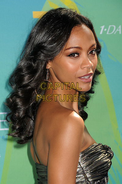 Zoe Saldana.2011 Teen Choice Awards - Arrivals held at Gibson Amphitheatre, Universal City, California, USA..August 7th, 2011.headshot portrait strapless gold side looking over shoulder strapless .CAP/ADM/BP .©Byron Purvis/AdMedia/Capital Pictures.