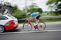Jasper Stuyven (BEL/Trek-Segafredo) speeding back to the peloton from behind a teamcar<br /> <br /> 69th Halle-Ingooigem 2016 (200km)