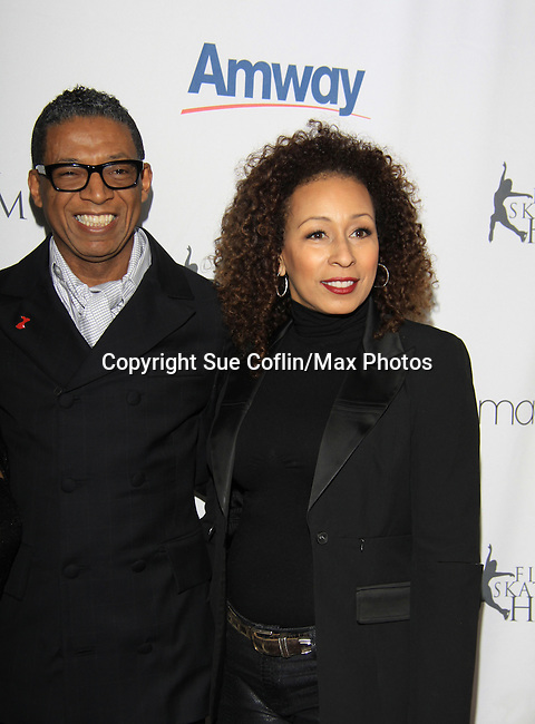 As The World Turns Tamara Tunie and designer B. Michael - The 2013 Skating with the Stars- a benefit gala for Figure Skating in Harlem on April 8, 2013 at Trump Wollman Rink, New York City, New York. (Photo by Sue Coflin/Max Photos)