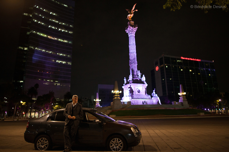 "Donovan parked at Mexico City's iconic Angel of Independence monument, smoking and listening to his favorite AM radio station in Mexico City on May 25, 2015. Some nights he will spend up to an hour there, peacefully watching over the empty streets. Donovan Tavera, 43, is the director of ""Limpieza Forense México"", the country's first and so far the only government-accredited forensic cleaning company. Since 2000, Tavera, a self-taught forensic technician, and his family have offered services to clean up homicides, unattended death, suicides, the homes of compulsive hoarders and houses destroyed by fire or flooding. Despite rising violence that has left 70,000 people dead and 23,000 disappeared since 2006, Mexico has only one certified forensic cleaner. As a consequence, the biological hazards associated with crime scenes are going unchecked all around the country. Photo by Bénédicte Desrus"