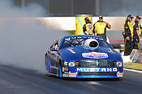 Feb. 14, 2013; Pomona, CA, USA; NHRA pro stock driver Larry Morgan during qualifying for the Winternationals at Auto Club Raceway at Pomona.. Mandatory Credit: Mark J. Rebilas-