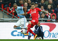 Fernandinho of Manchester City and Alberto Moreno of Liverpool in an early battle for the ball during the Capital One Cup match between Liverpool and Manchester City at Wembley Stadium, London, England on 28 February 2016. Photo by David Horn / PRiME Media Images.